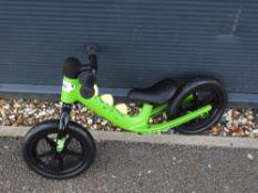 Green dinosaur style balance bike