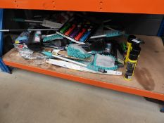 Large underbay of de-icer, cleaning cloths, wiper blades, brushes, etc