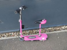Pink electric scooter with charger