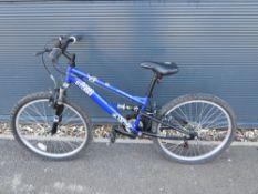 Blue childs Apollo mountain bike
