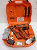 Paslode Impulse IM90 nail gun, charger, safety glasses, lubricant oil and storage case
