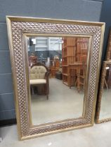 Rectangular bevelled mirror in decorated painted frame