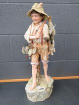 Continental china figure of boy with wild fowl