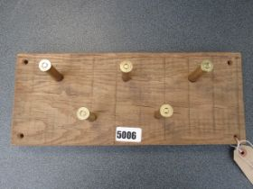 Dog lead rack with brass cartridge cases