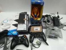 Bag containing PS1 games console and various gaming accessories; controllers, stands, etc