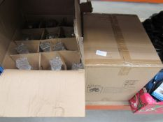 2 boxes containing decorative decanters