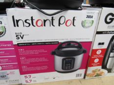 (TN56) Instant Pot multi use pressure cooker, with box