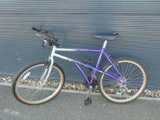 Carrera purple and silver childs mountain bike
