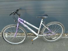 4050 - Optima Storm purple and silver girls mountain bike