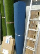 Two rolls of blue industrial style carpet