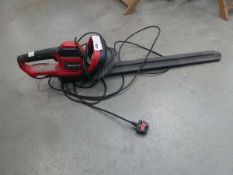 Red electric hedgecutter
