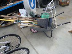 Wheelbarrow of assorted garden tools