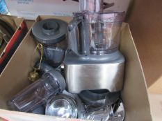 Box containing a Kenwood food processor with attachments