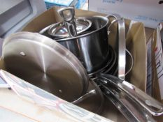 Box containing mixed used Kirkland pots and pans