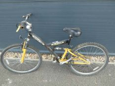 Black and yellow childs suspension mountain bike