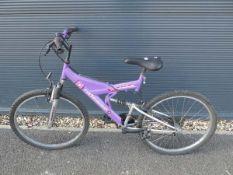 Pink suspension mountain bike