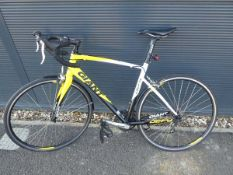 Yellow, black and white Giant Defy racing cycle
