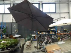 Grey cantilever umbrella with stand