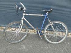 Carrera blue and grey mountain bike