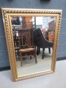 Rectangular bevelled mirror in gilt rope twist frame