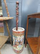 Oriental stick stand, plus a carved African walking stick Good condition
