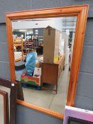 Rectangular bevelled mirror in pine frame