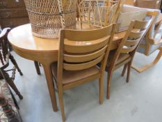 Oval teak extending dining table and 4 ladder back chairs Collector's item: see Soft Furnishings