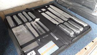 Zip case containing Samurai 9pce knife set