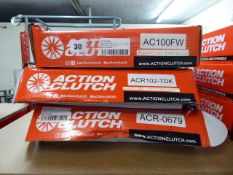 Three assorted Action Clutch fly wheels and clutch kits