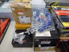 Five assorted products to include Mishimoto radiator hose kit, Driftworks camber arms and other