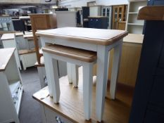 White painted oak top nest of 2 tables