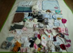 Selection of mixed children's accessories to include hats, socks, blankets, bibs, etc
