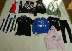Selection of sportswear to include Nike, Puma, On Field, etc (sizes on 2nd photo)