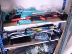 2 small shelves of car cleaning accessories, wiper blades and frost blockers