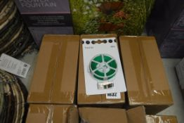 3 boxes containing 36 packs of twist plant tie