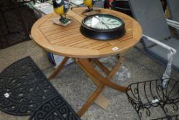 Teak circular garden table