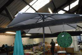 Beige garden parasol with metal pole