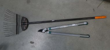Pair of loppers and a garden rake