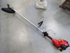 Homelite red petrol powered brush cutter