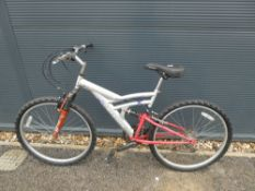 Falcon silver and red suspension mountain bike