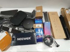 Bag containing remotes, plug extensions, routers, tripod, etc