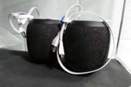 Two Ultimate Ears Wonderboom 2 portable bluetooth speakers with charging cables