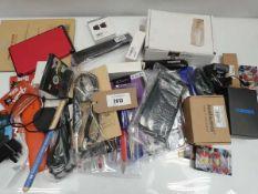 Bag containing watch repair kits, guitar pedal, keypad reader, tablet cases, drumsticks etc