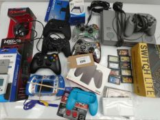Bag containing gaming related accessories; PS1 console, Nitntendo DS, Gameboy Advance games,