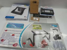 Bag containing laptop stands, laptop table, VCR cleaner, spare laptop keyboard