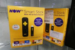 Two Now TV smart sticks with boxes