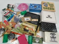 Bag containing smoking accessories; boxes, trays, papers, herb grinders