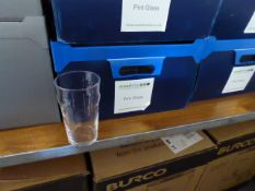 Stack of 4 plastic boxes containing approximately 60 pint glasses