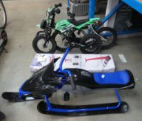 Boxed snow scooter, plastic snow buggy and two small children's bikes