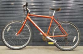 Saracen orange mountain bike